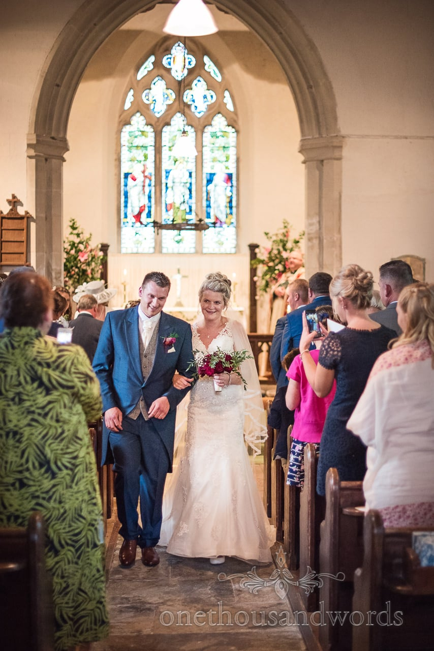 Newlyweds come down the aisle as husband and wife