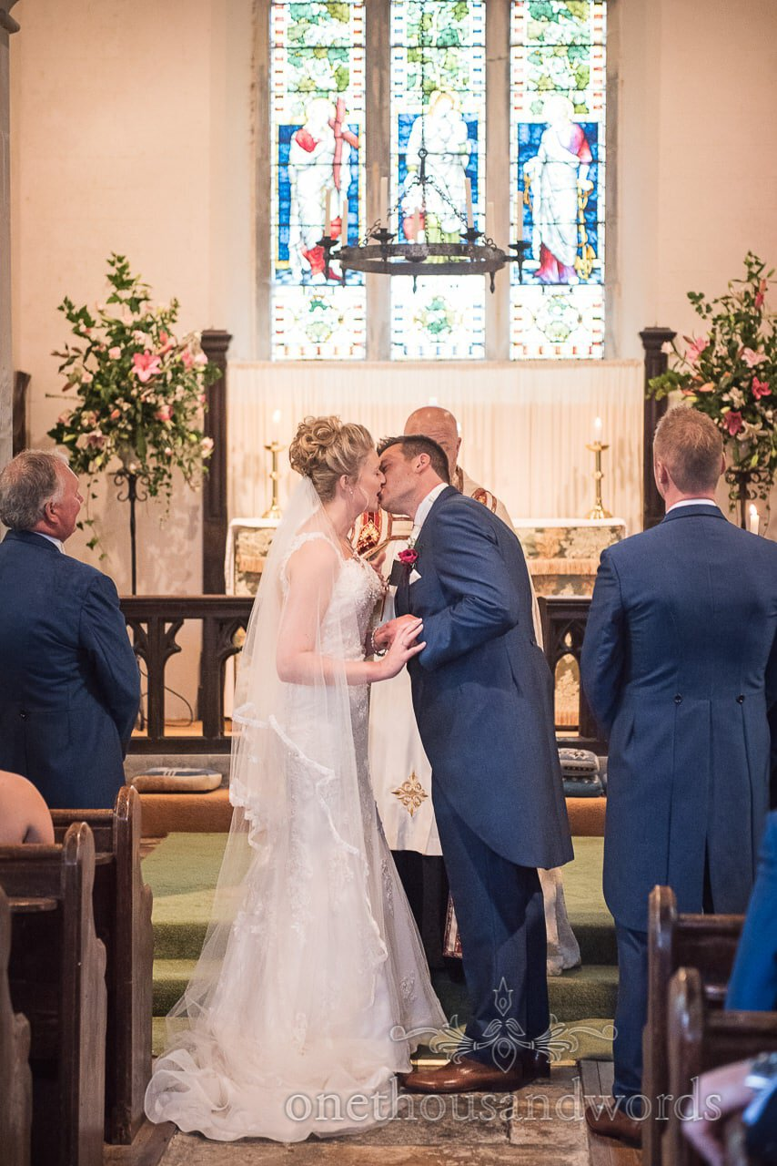 Newlyweds first kiss during village church ceremony