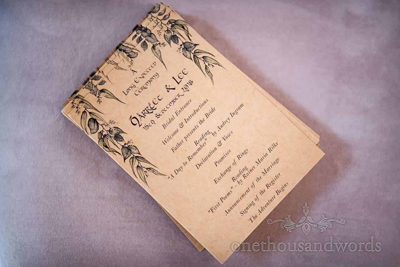 Order of service from Lord of the Rings woodland Lulworth Castle wedding