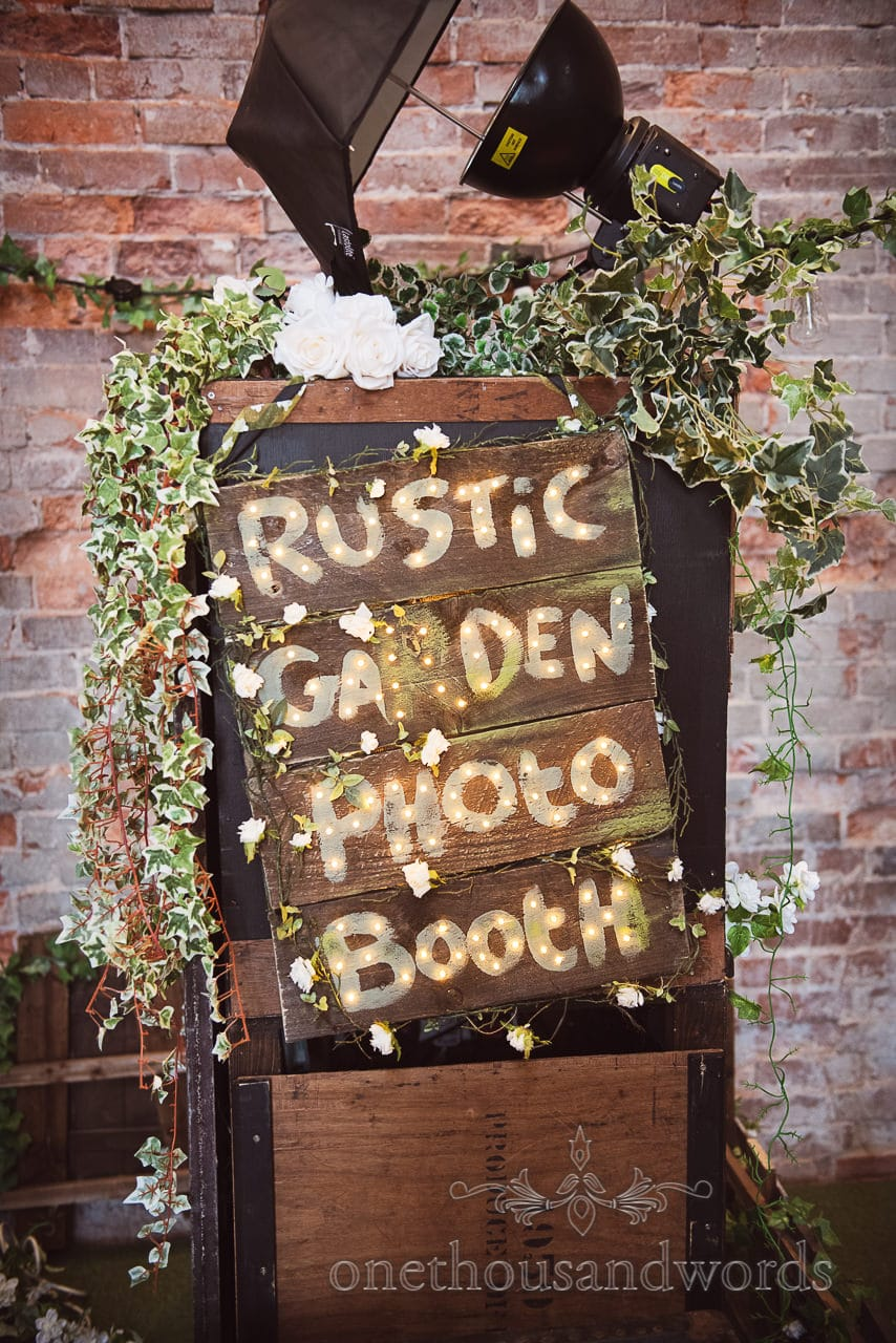 Rustic Garden Photo booth sign with ivy at Lulworth Castle Wedding venue