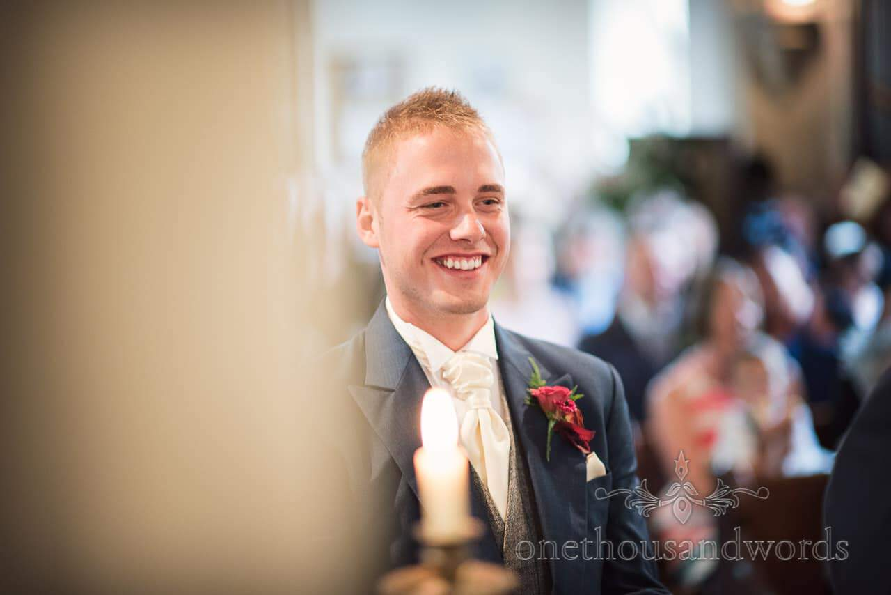 Smiling best man during church wedding ceremony