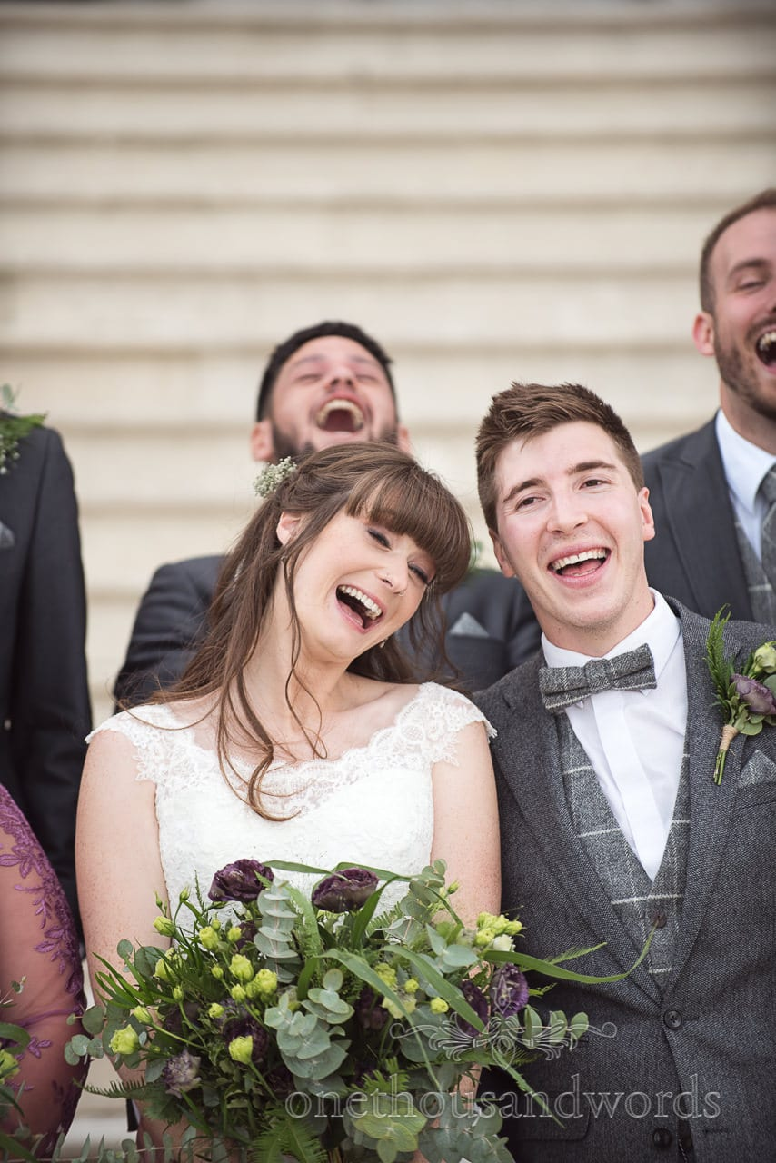Smiling bride and groom from woodland Lulworth Castle wedding