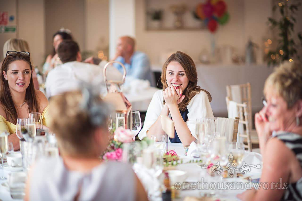 Smiling guest during speeches at Italian Villa wedding
