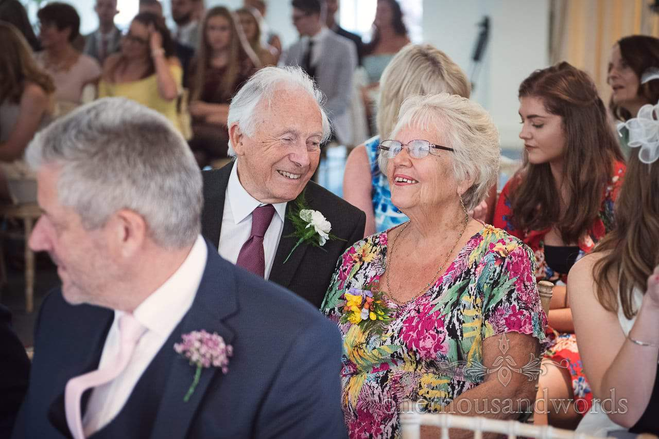 Smiling guests during ceremony at Italian Villa wedding