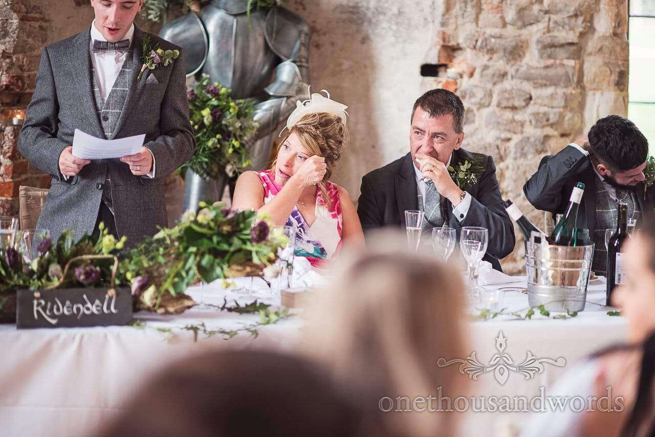 Tears at top table during speech at woodland Lulworth Castle wedding