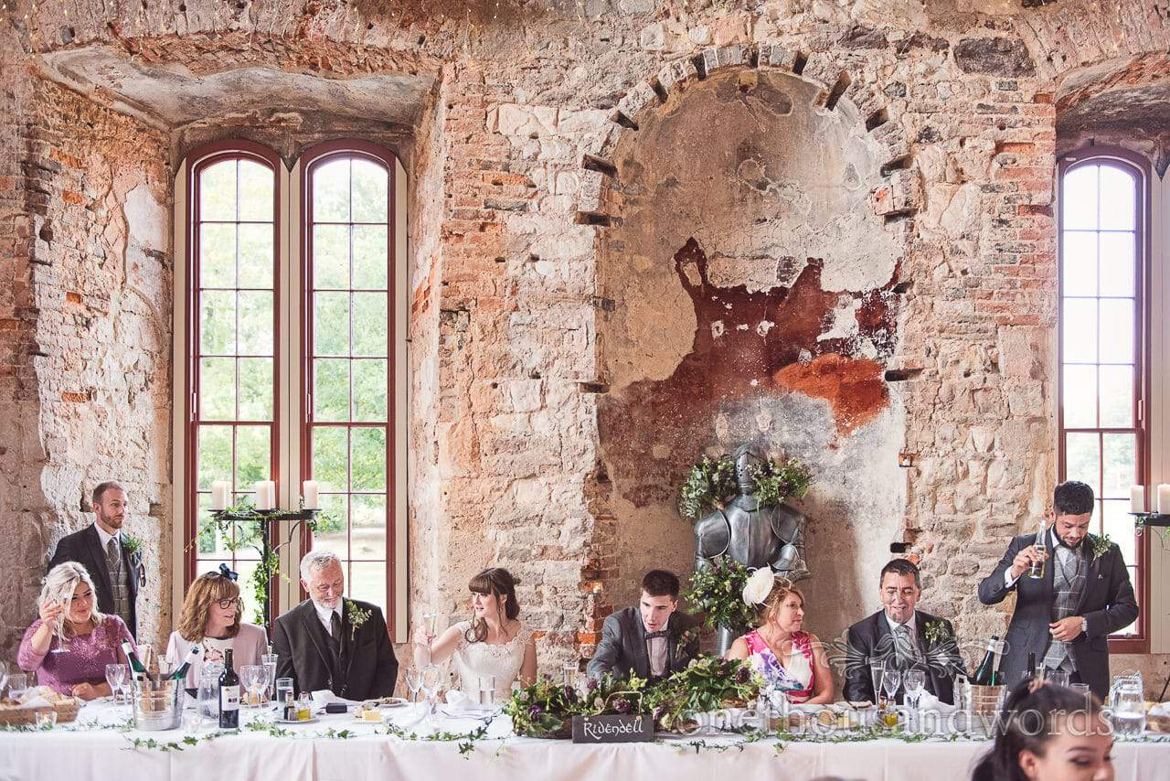 Top table during best mans speech at woodland Lulworth Castle wedding