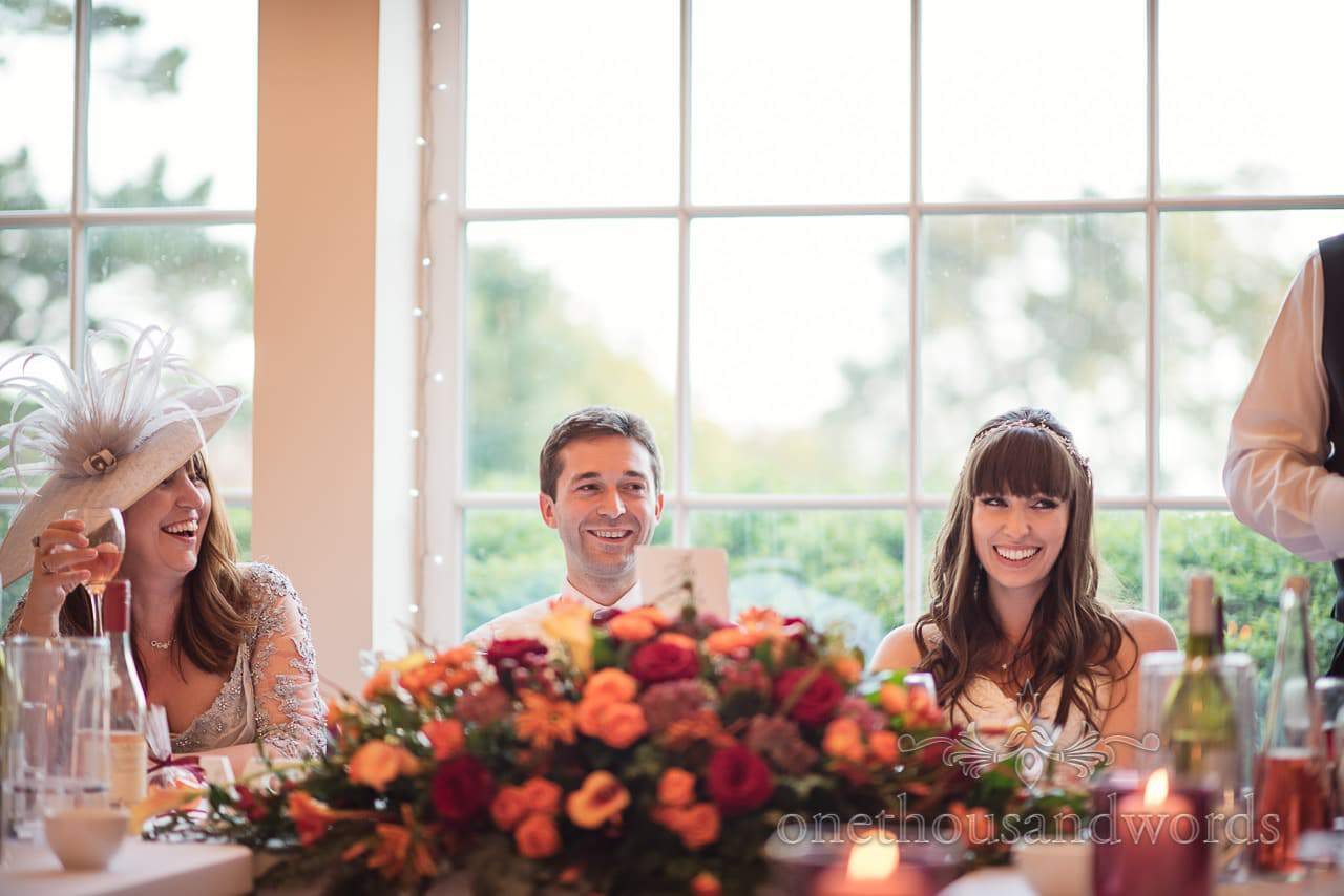 Top table laughing at father of the bride's wedding speech