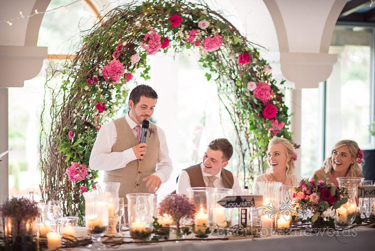 Top table reaction to best mans speech at Italian Villa wedding