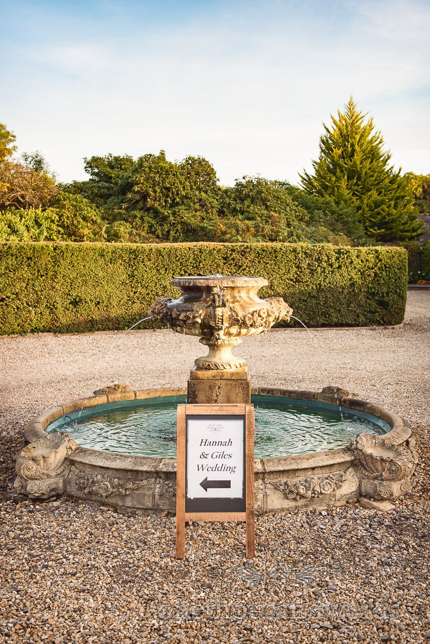 Water fountain with wedding sign at Hethfelton House Wedding venue