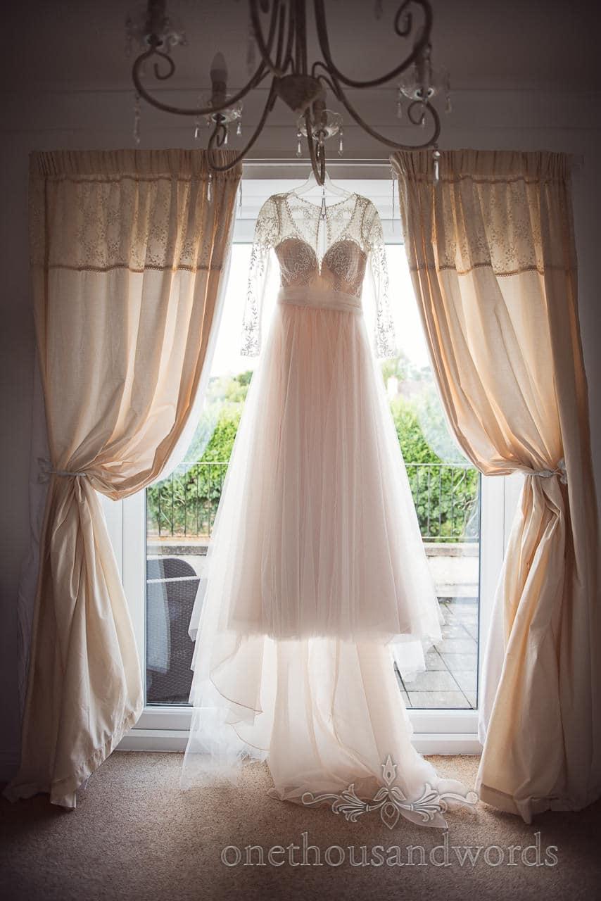 Wedding dress is illuminated by sunlight before Italian Villa wedding