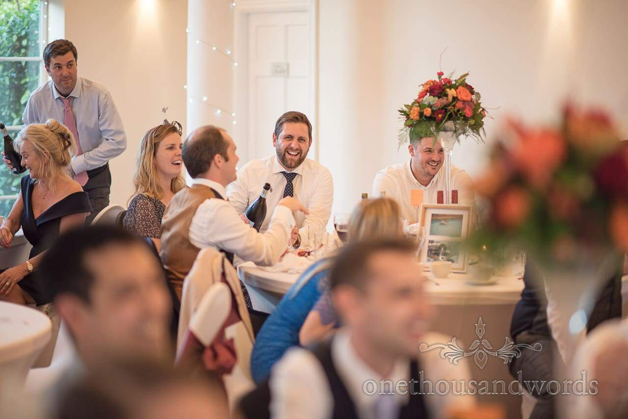 Wedding guests laughing during speeches at Hethfelton House Wedding