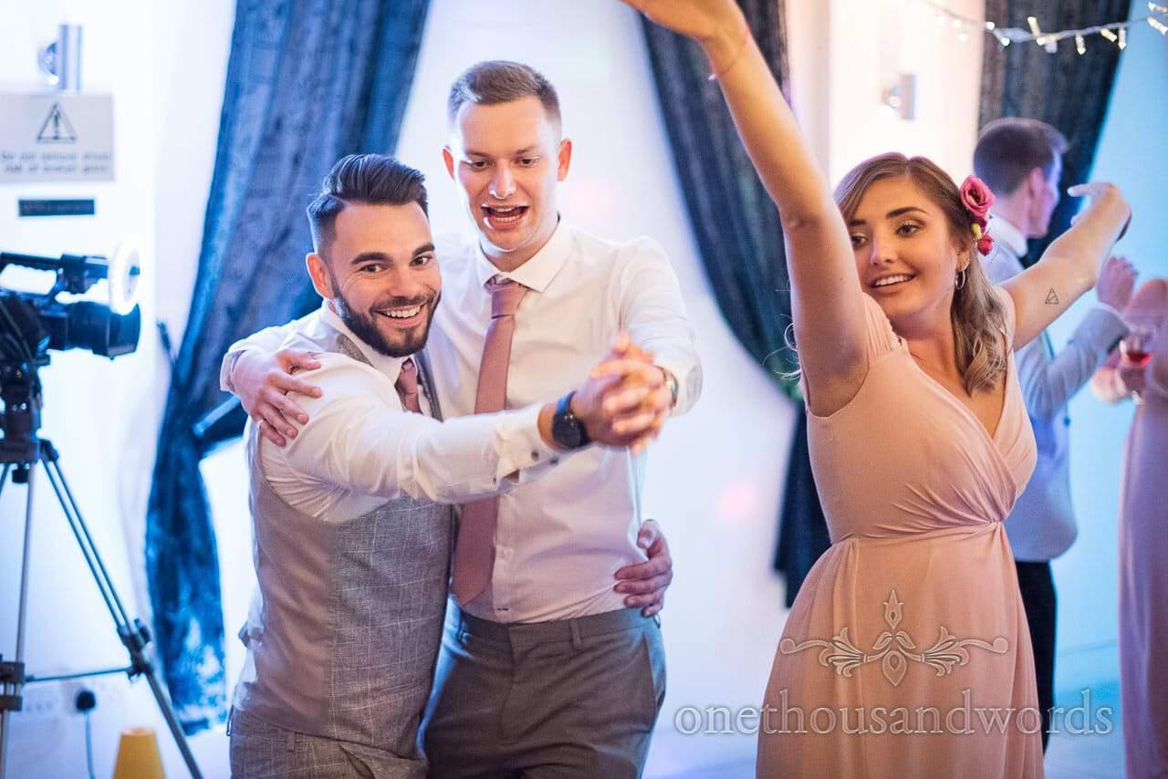 Wedding guests on the dance floor at The Italian Villa Wedding venue in Poole