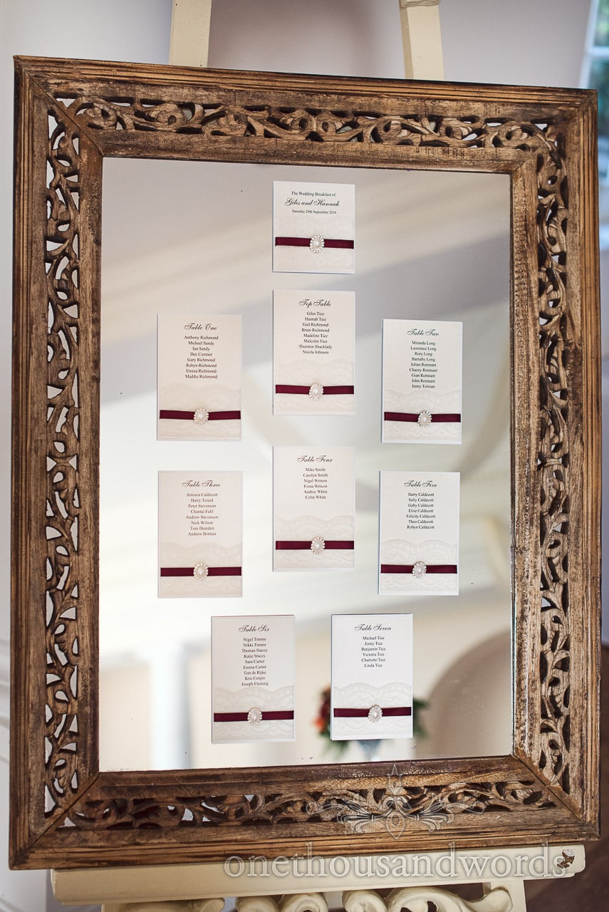 Wooden framed mirrored wedding table plan at Hethfelton House