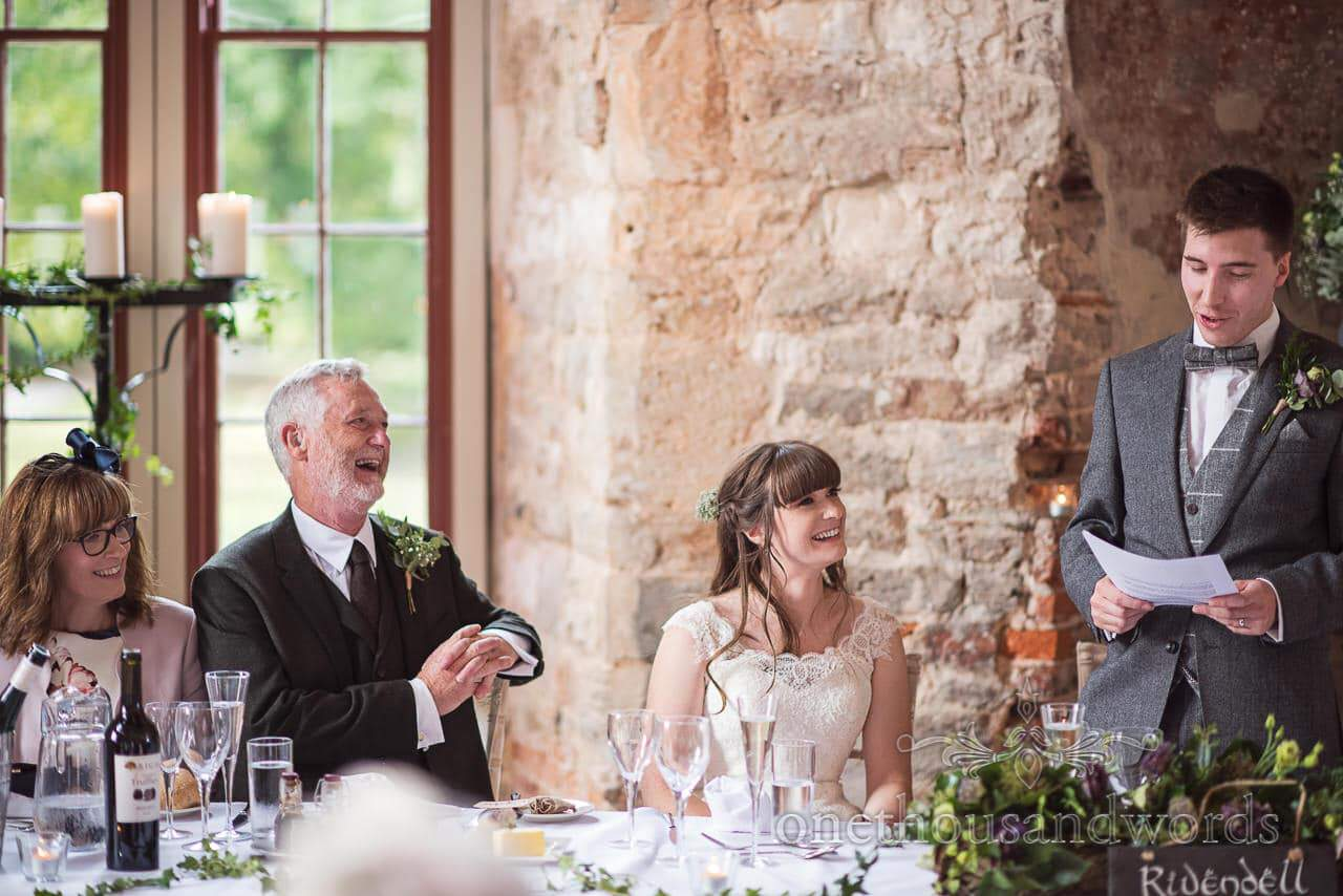 Woodland Lulworth Castle wedding photo of father of the brides reaction