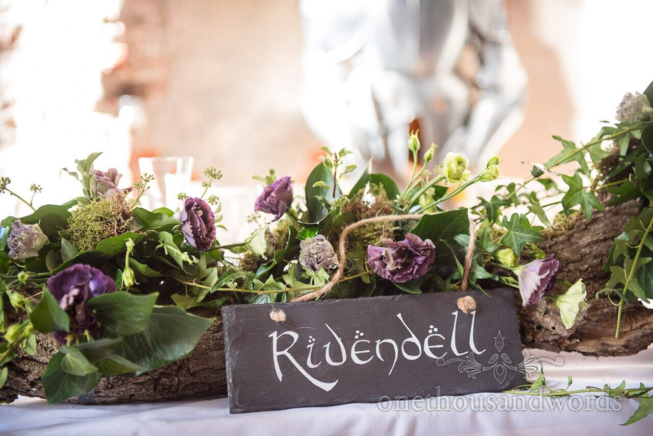 Woodland Lulworth Castle wedding photos Lord of the Rings table name