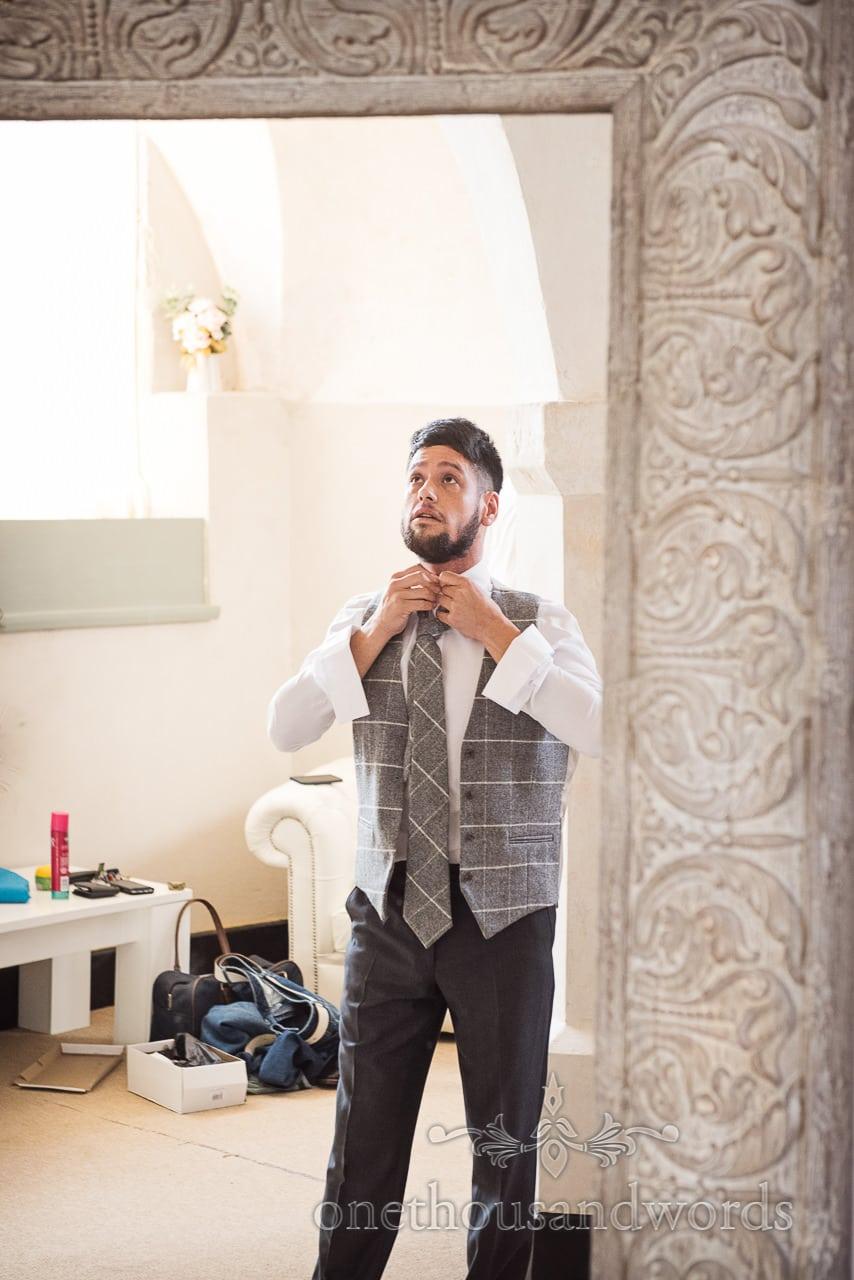 Woodland Lulworth Castle wedding Photos of best man in mirror