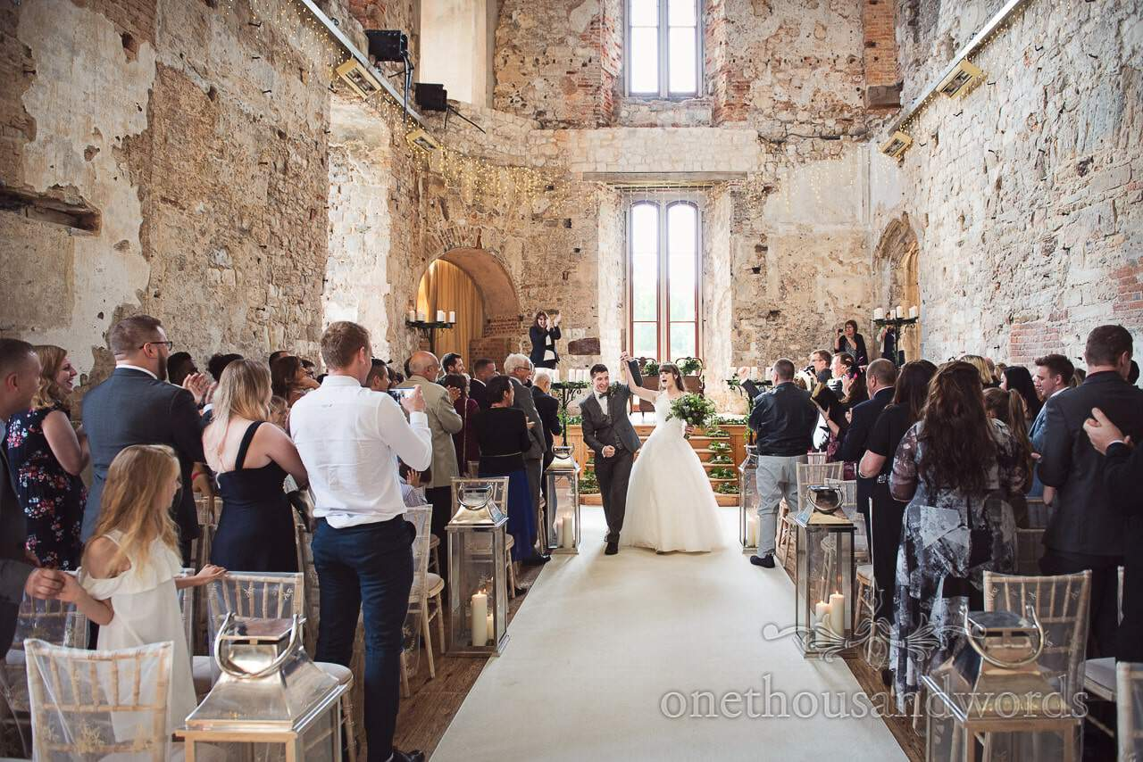 Woodland Lulworth Castle wedding photos of bride and groom coming down the aisle