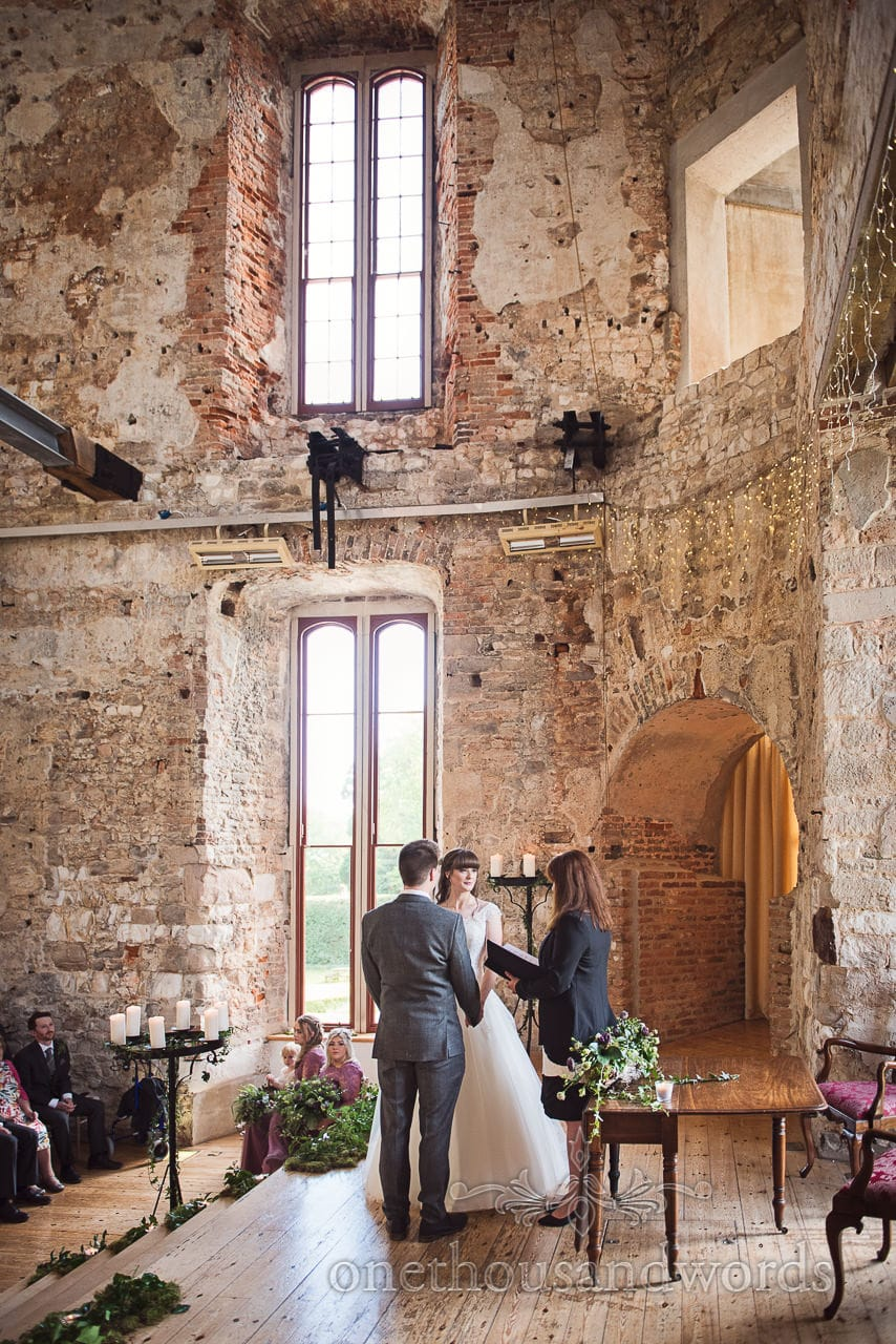 Woodland Lulworth Castle wedding photos of bride and groom during ceremony