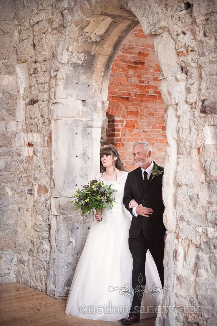 Woodland Lulworth Castle wedding photos of bride arriving with father