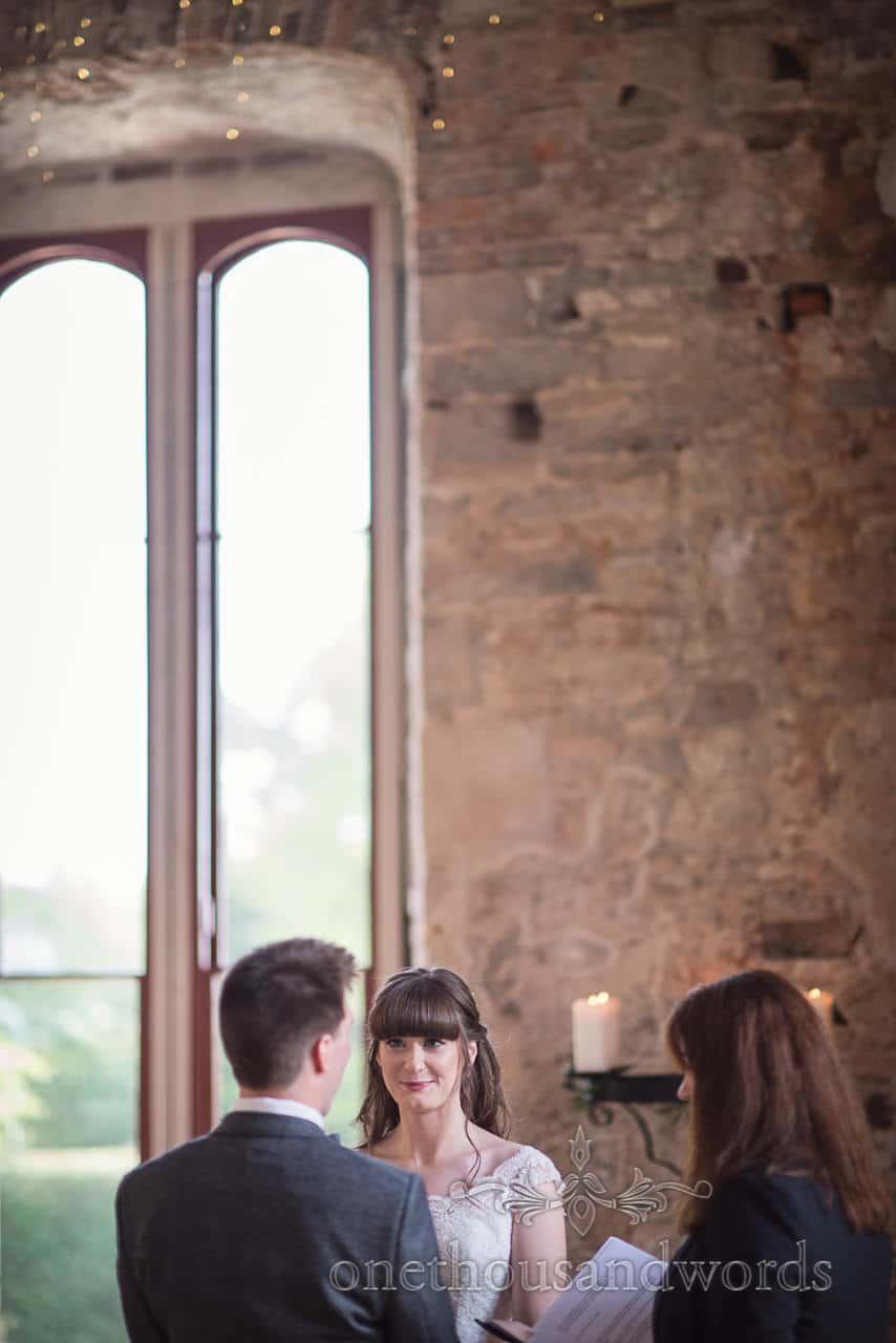 Woodland Lulworth Castle wedding photos of bride looking at groom