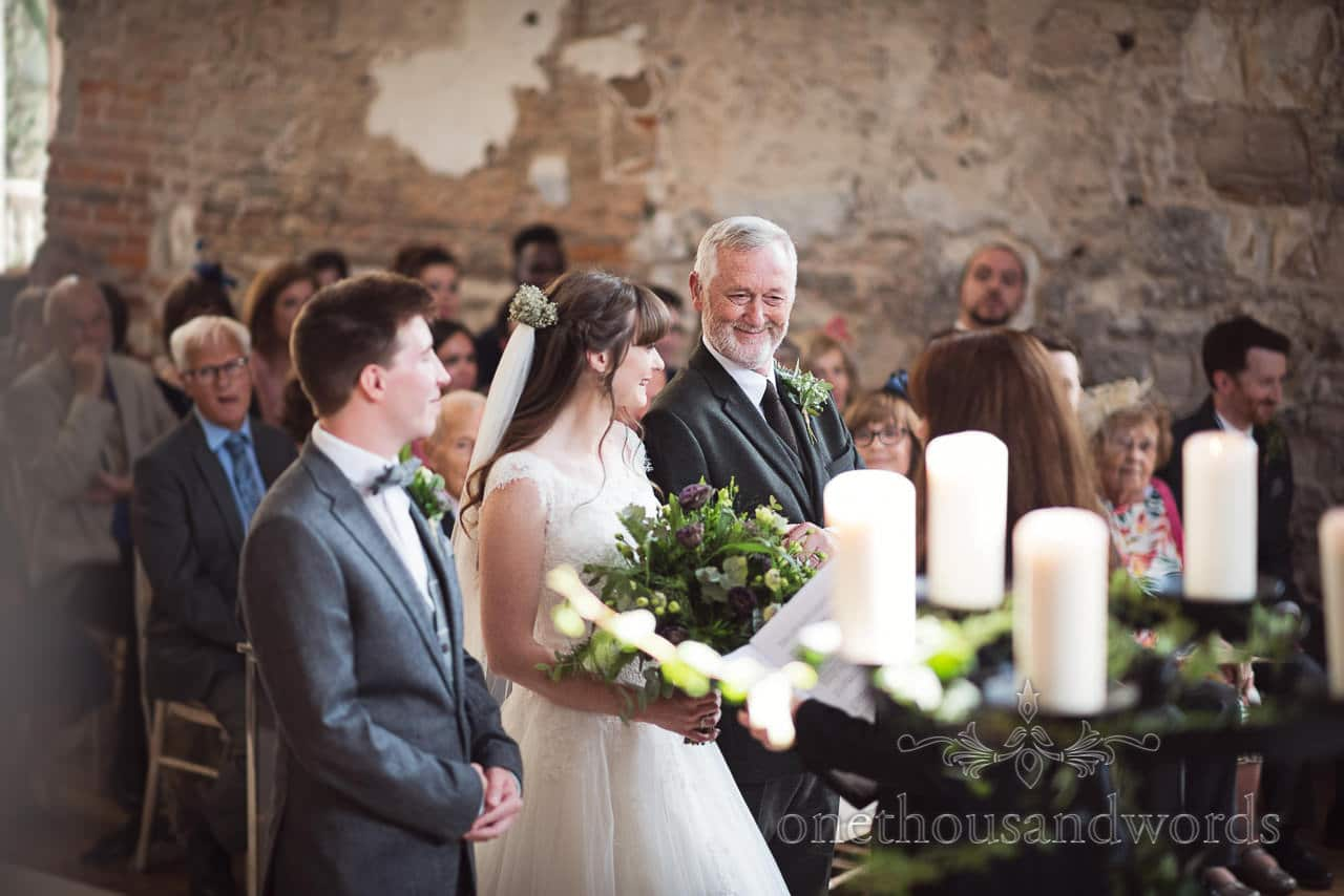 Woodland Lulworth Castle wedding photos of father of the bride with bride and groom