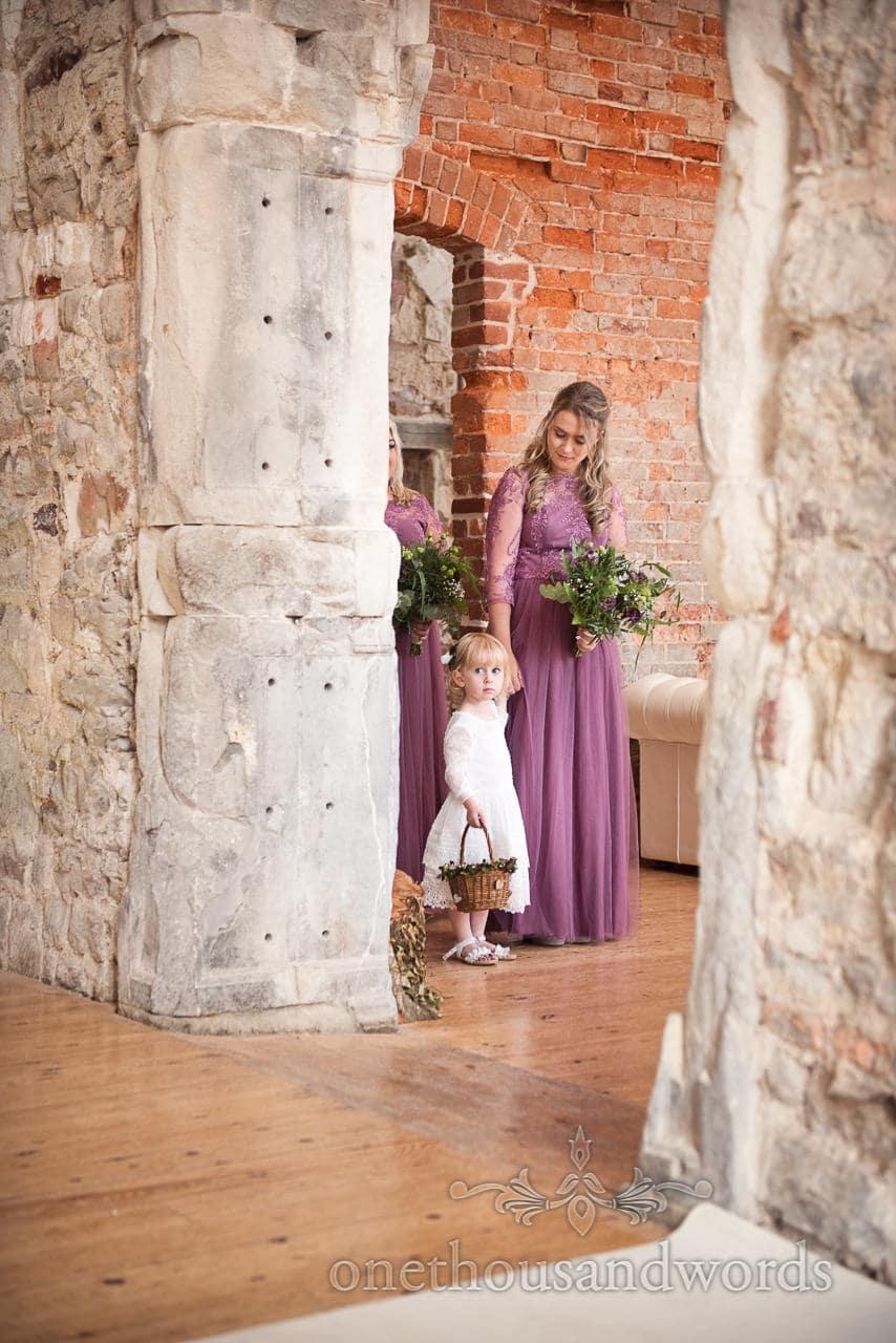 Woodland Lulworth Castle wedding photos of flower girl and bridesmaid