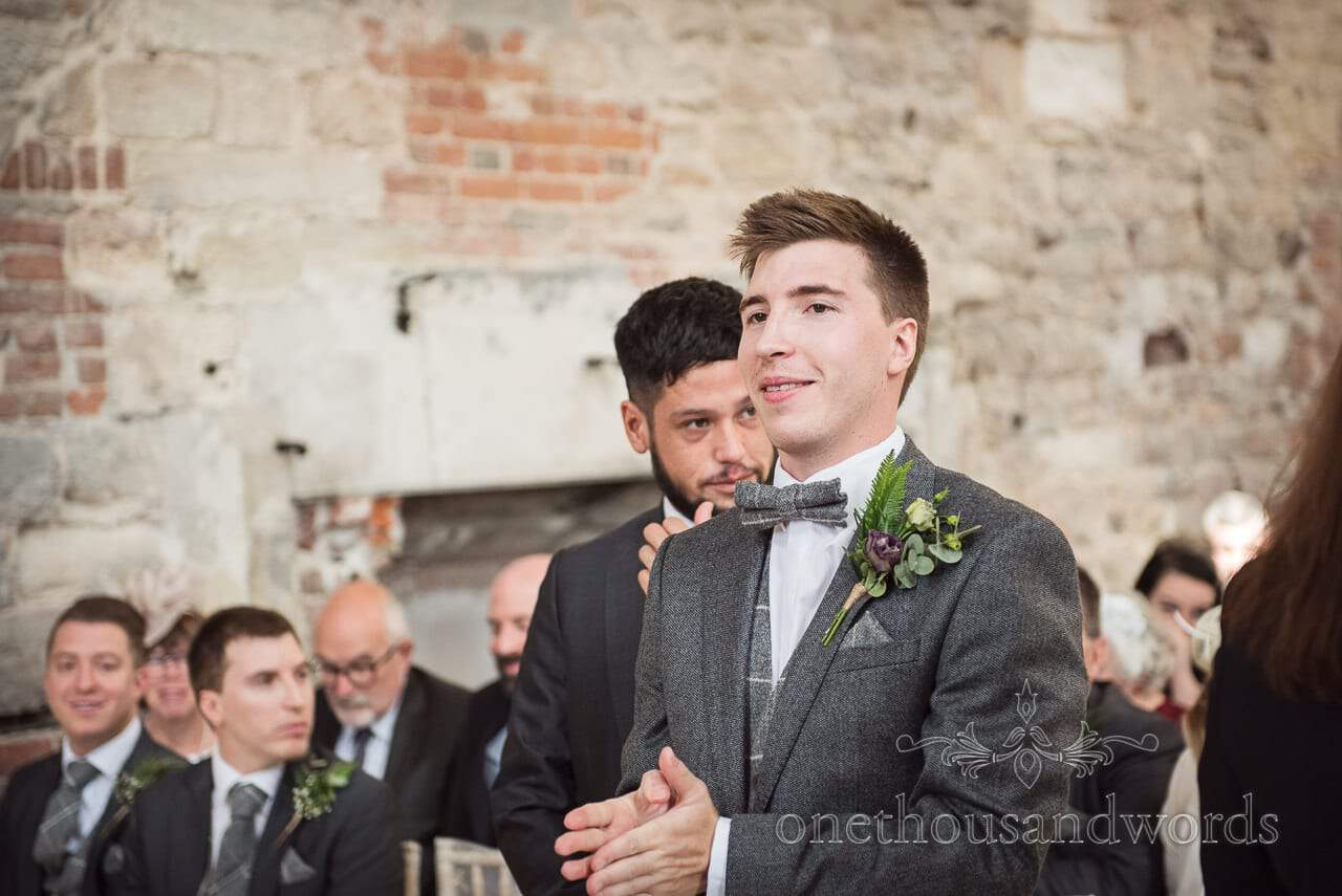 Woodland Lulworth Castle wedding photos of groom getting game face on