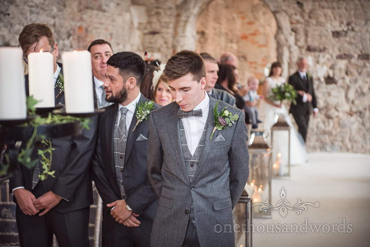Woodland Lulworth Castle wedding photos of groom just before he sees his bride