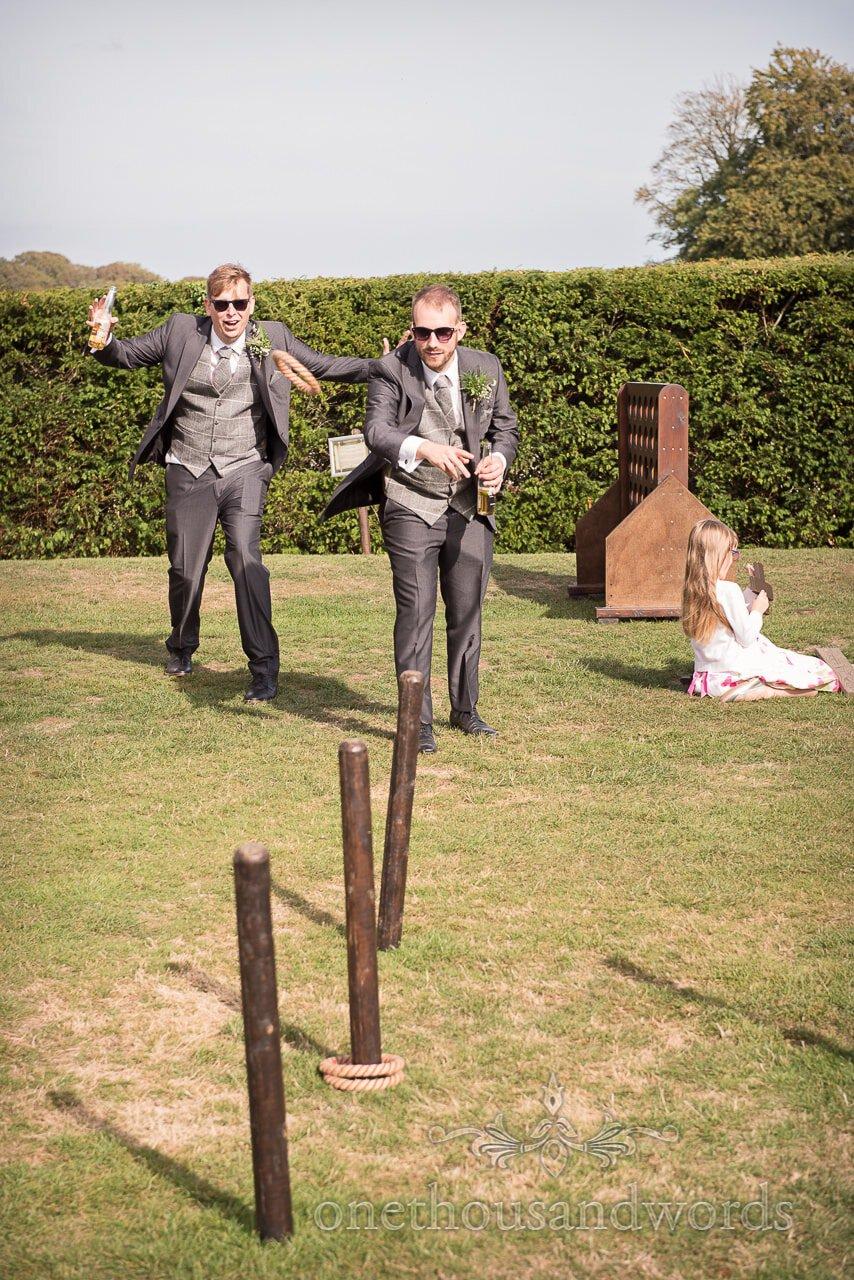 Woodland Lulworth Castle wedding photos of groomsmen enjoying garden game