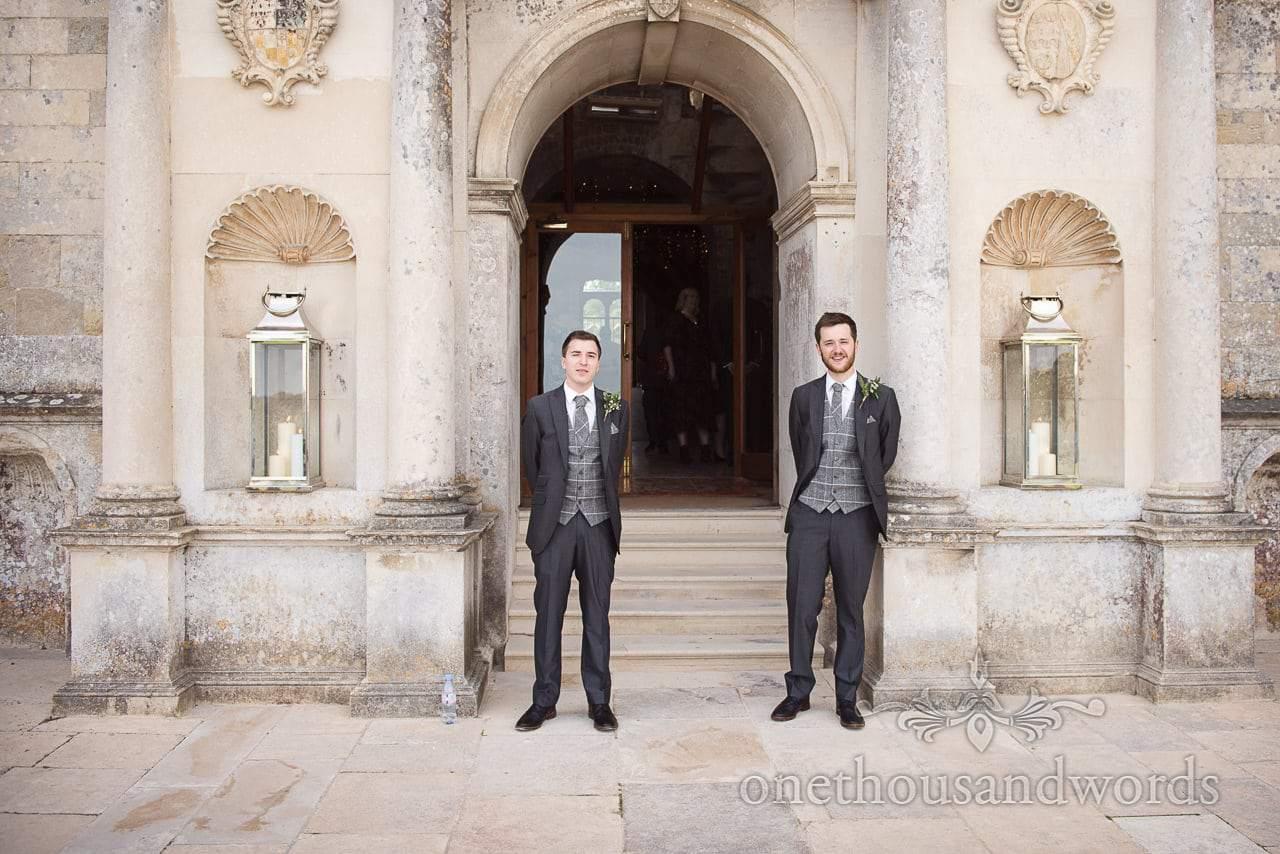 Woodland Lulworth Castle wedding photos of groomsmen outside castle door