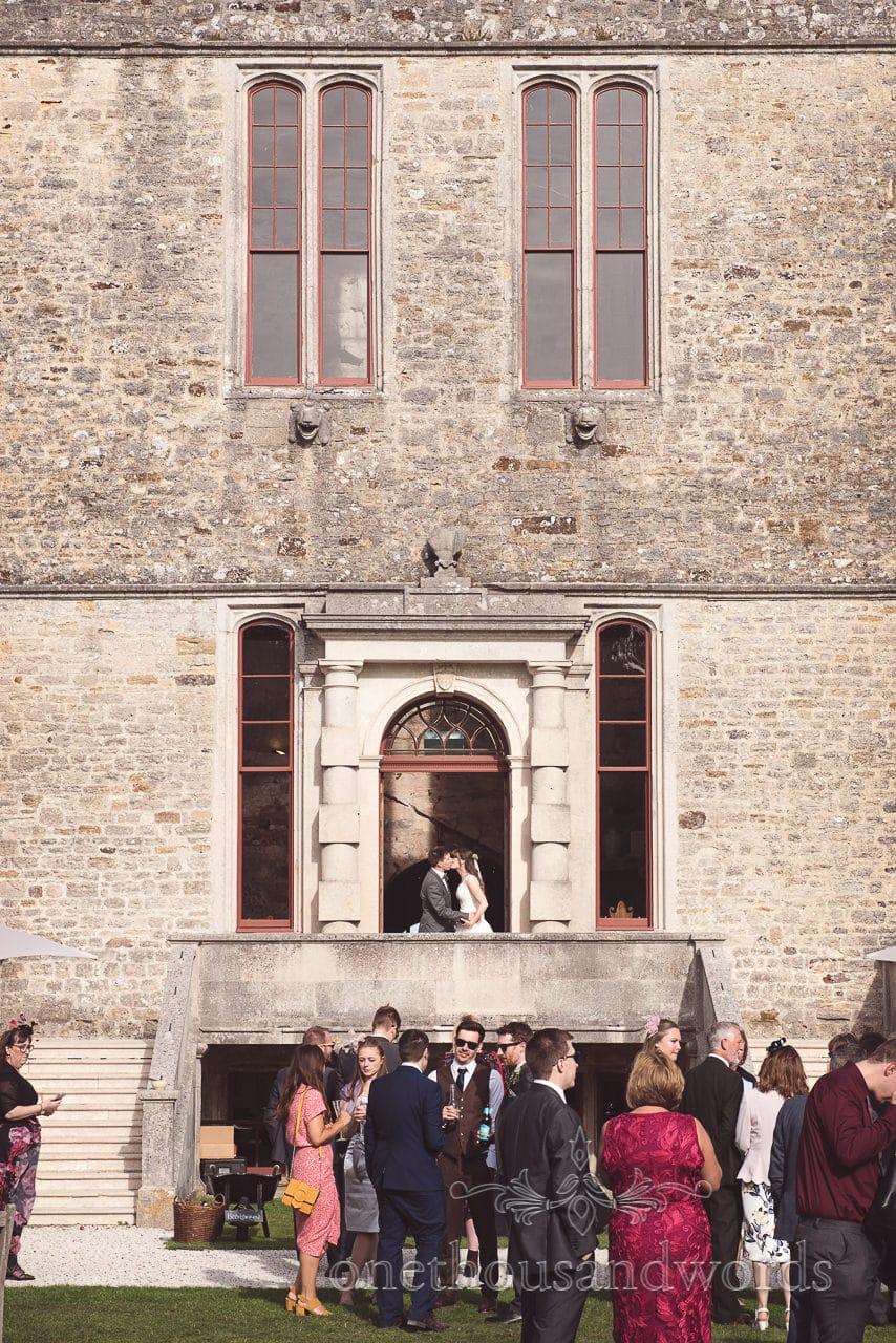 Woodland Lulworth Castle wedding photos of kissing newlyweds on staircase