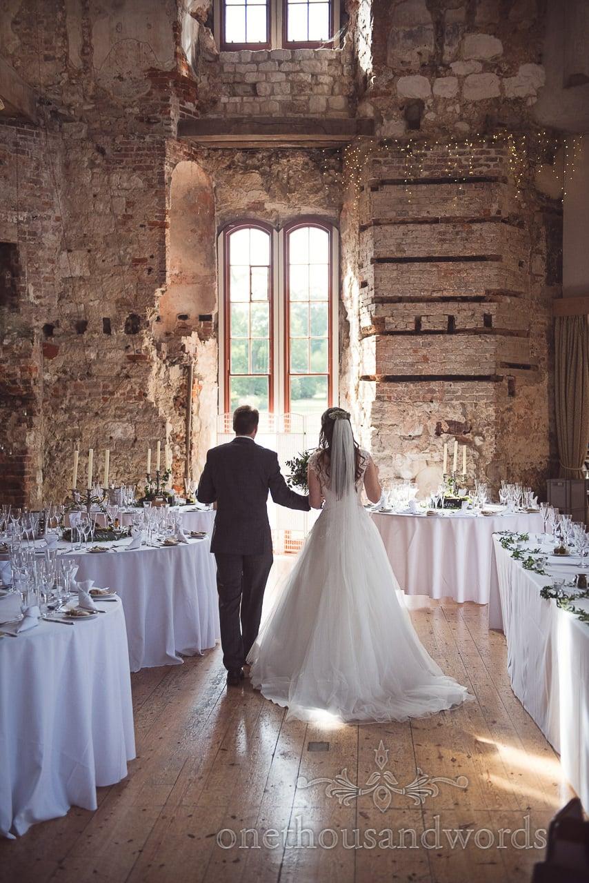 Woodland Lulworth Castle wedding photos of newlyweds in dining room