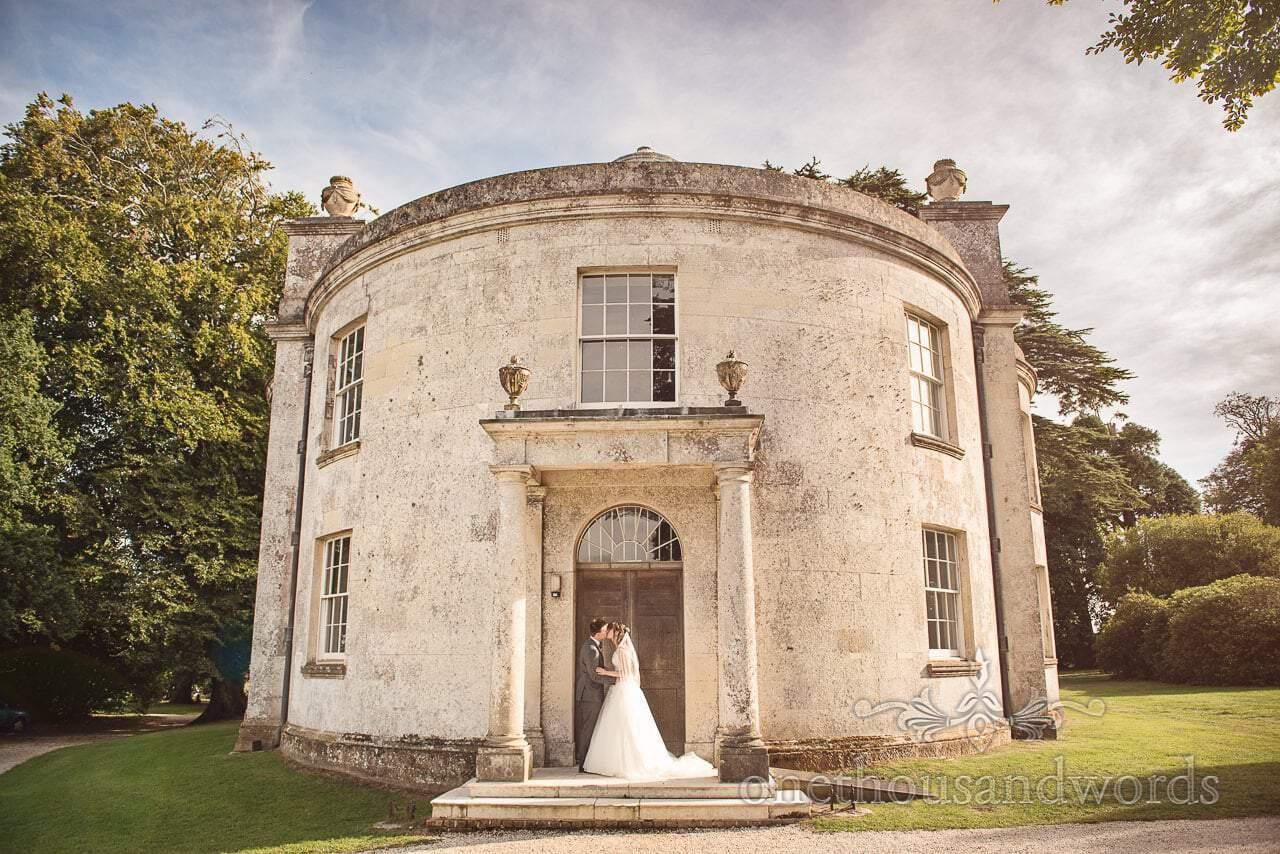 Woodland Lulworth Castle wedding photos of newlyweds outside catholic chapel