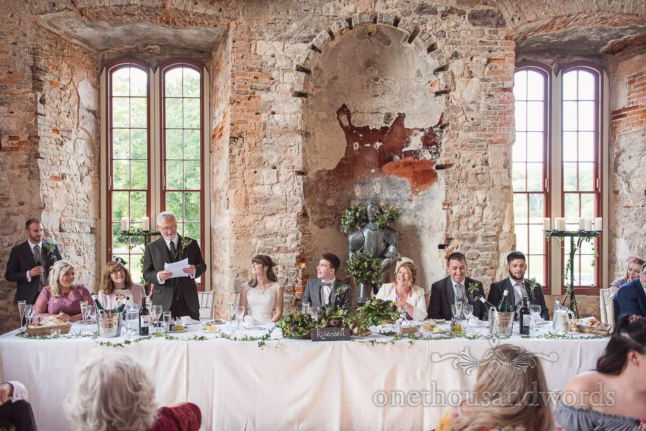 Woodland Lulworth Castle wedding photos of top table during father of the bride speech