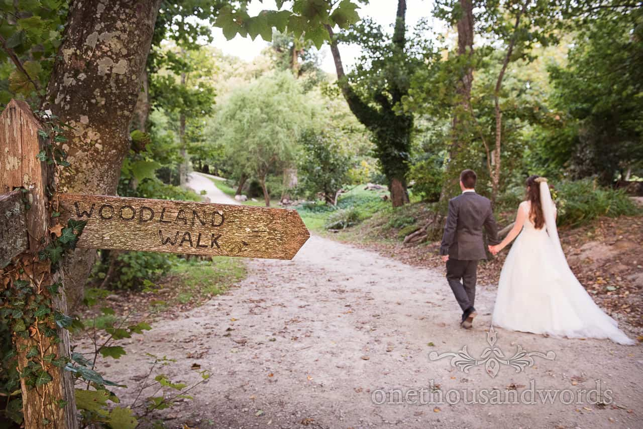Woodland walk with bride and groom at Lulworth Castle Wedding venue in Dorset