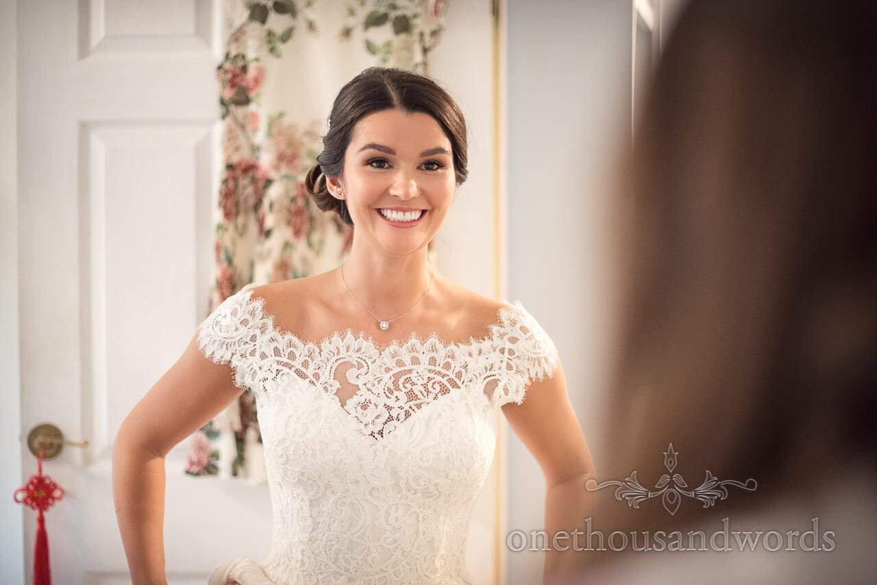 Best wedding bridal portrait photograph happy bride in dress smiling