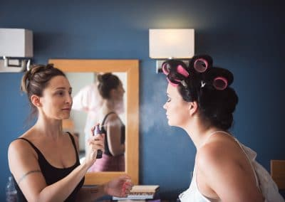 Bride has wedding makeup set with spray at Sandbanks Hotel Wedding preparations