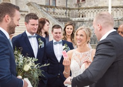Drinks reception wedding magician bride laughing at Lulworth Castle Wedding Photo