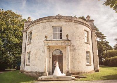 Lulworth Castle Catholic Chapel wedding couple kissing photograph
