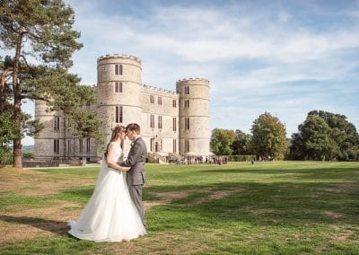 Lulworth Castle Wedding venue in Dorset bride and groom in gardens