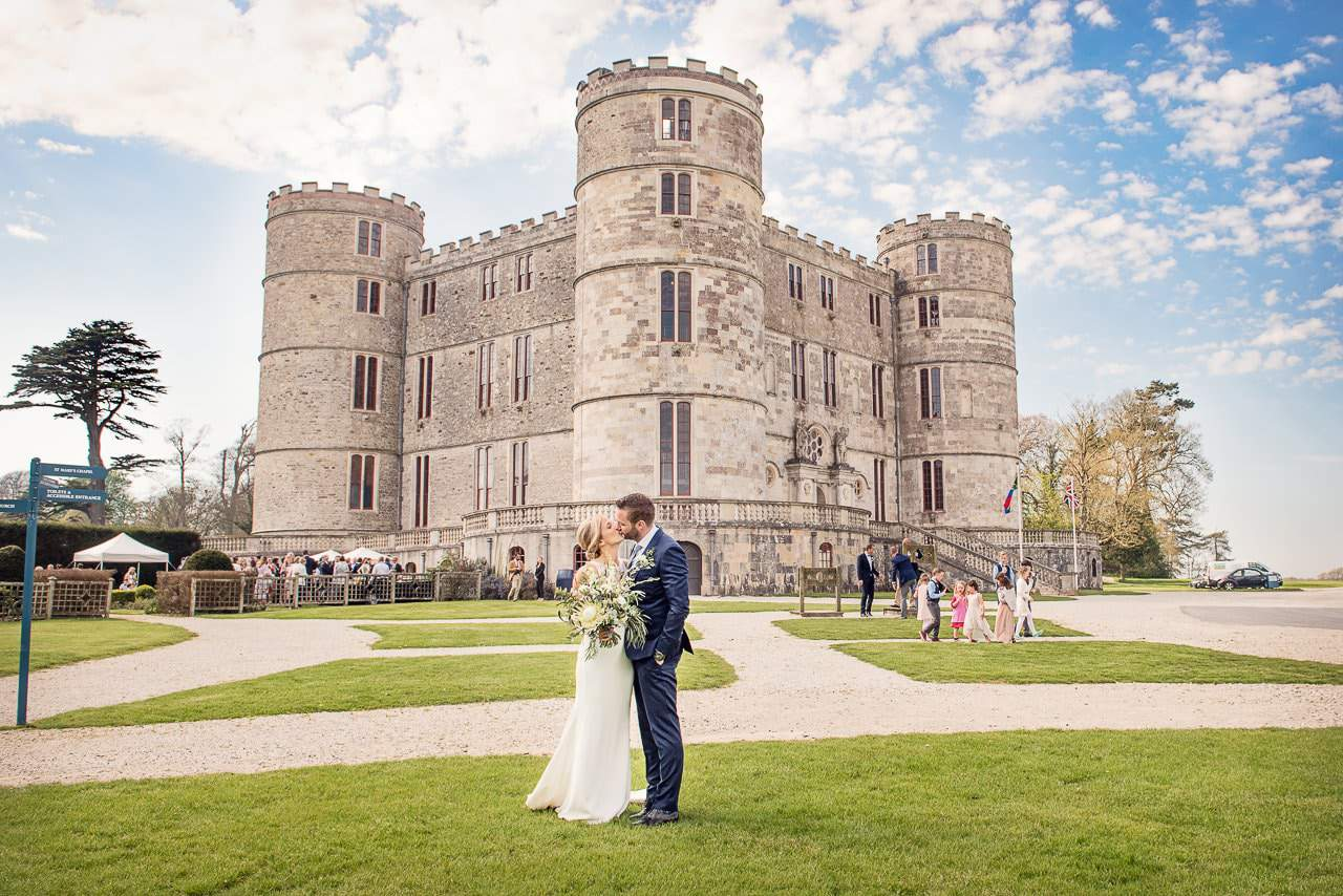 Lulworth Castle Wedding Venue in Dorset photo with bride and groom kissing