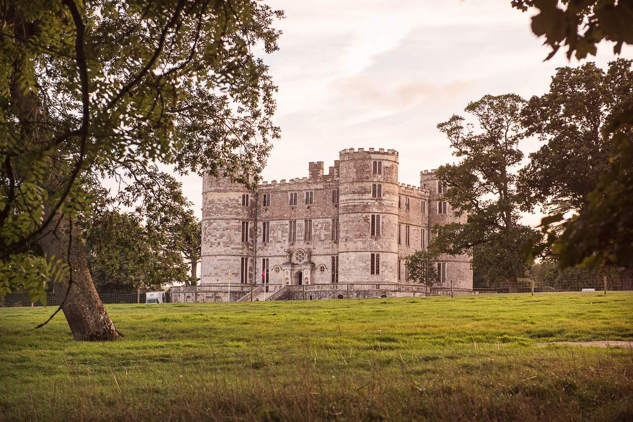 Lulworth Castle Wedding Venue in Dorset at Sunset by Recommended Photographer