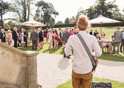 Wedding musician guitar at Lulworth Castle Wedding drinks reception in Dorset