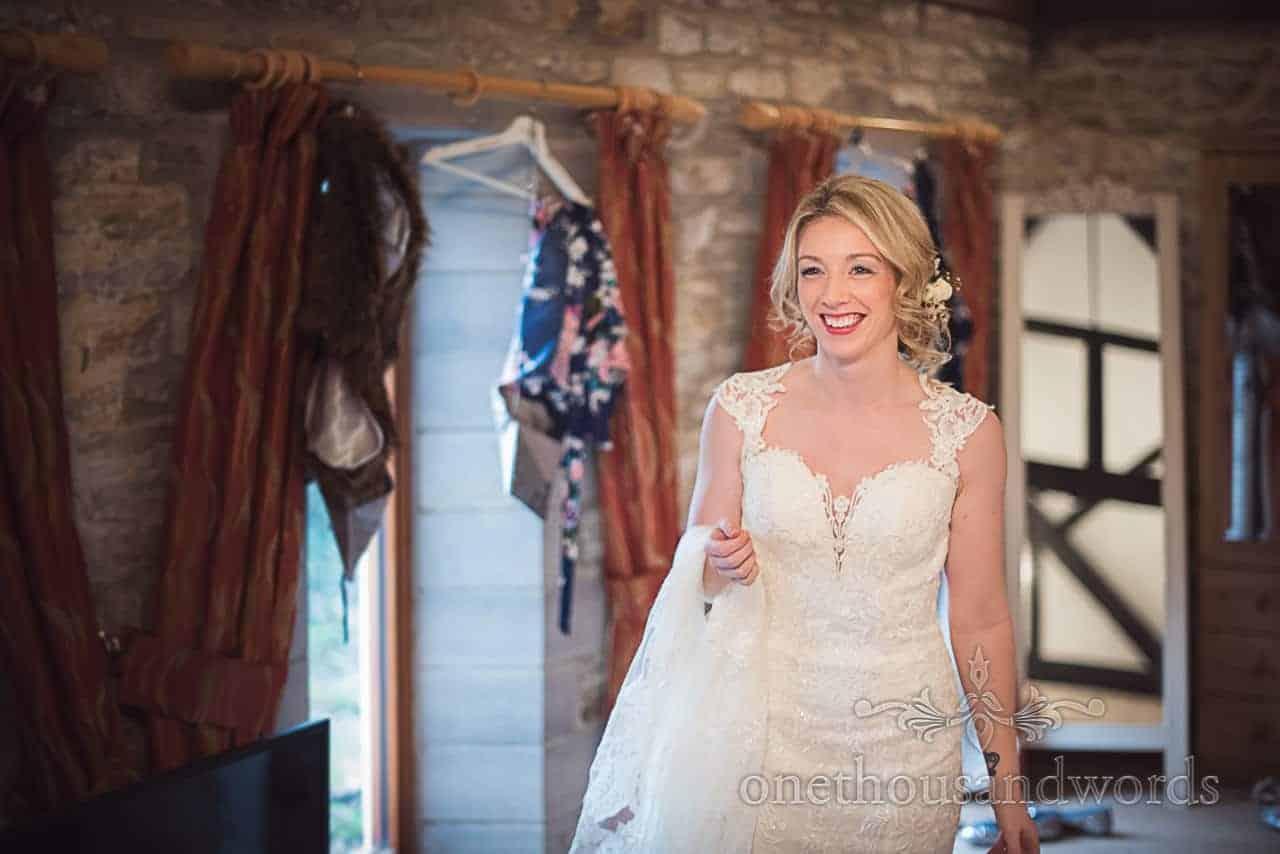 Beautiful blonde bride wears white detailed wedding dress on wedding morning