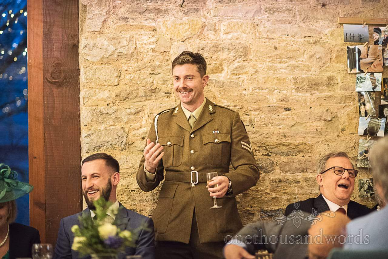 Best man in green army uniform gives wedding speech at Kingston Country Courtyard