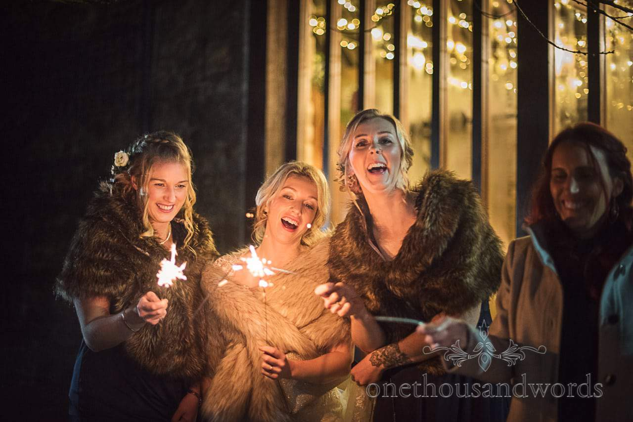 Bride and bridesmaids with wedding sparklers at Dorset Courtyard wedding venue