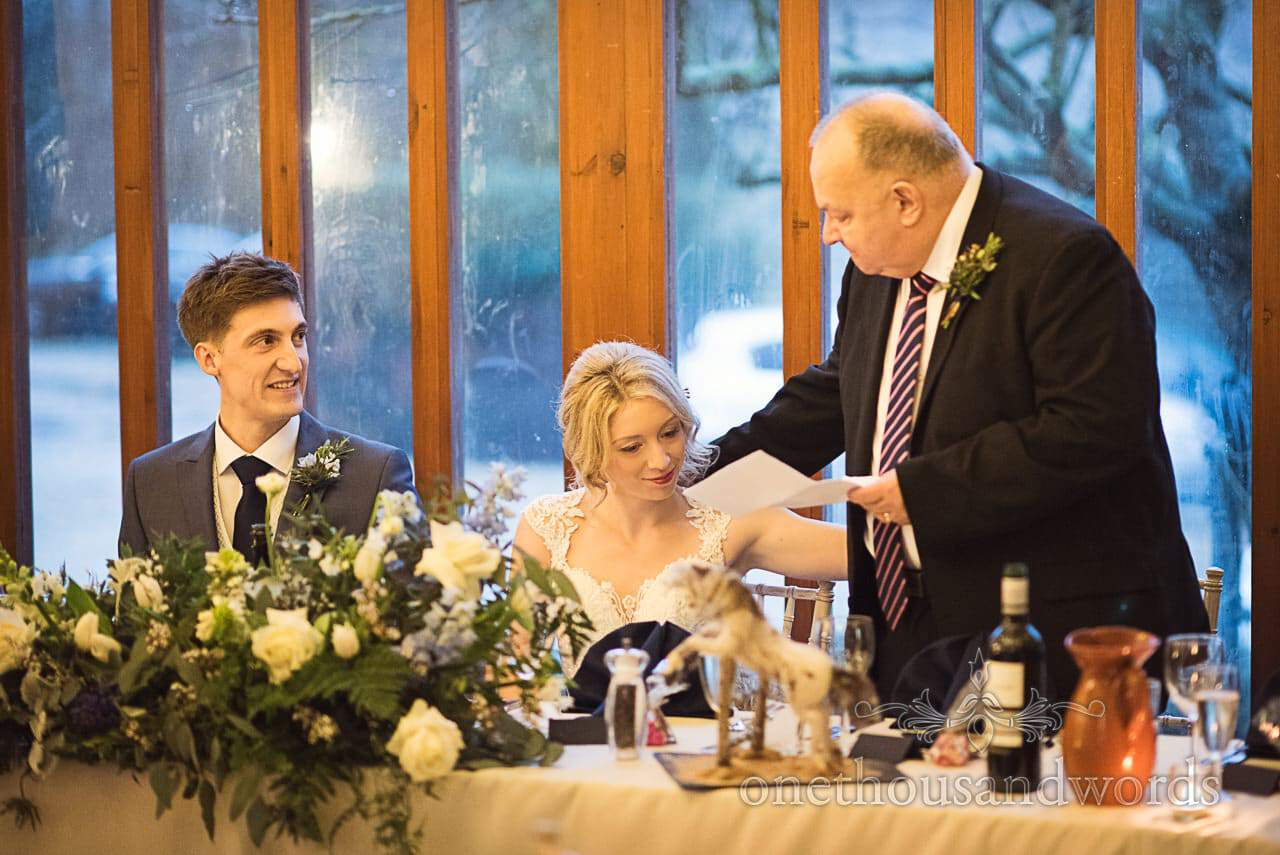 Bride hugs her father during wedding speeches at Kingston Country Courtyard