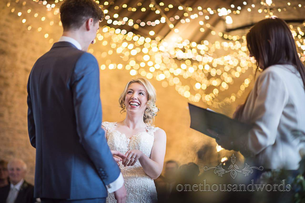 Bride laughing wedding ceremony fairy lights at Kingston Country Courtyard