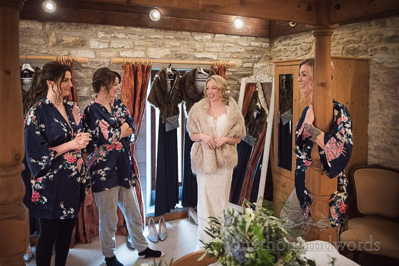 Bride wedding dress and bridesmaids in silk floral dressing gowns wedding morning