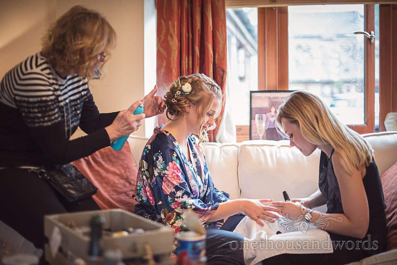 Bridesmaid has wedding morning nails and hair styled at Kingston Country Courtyard
